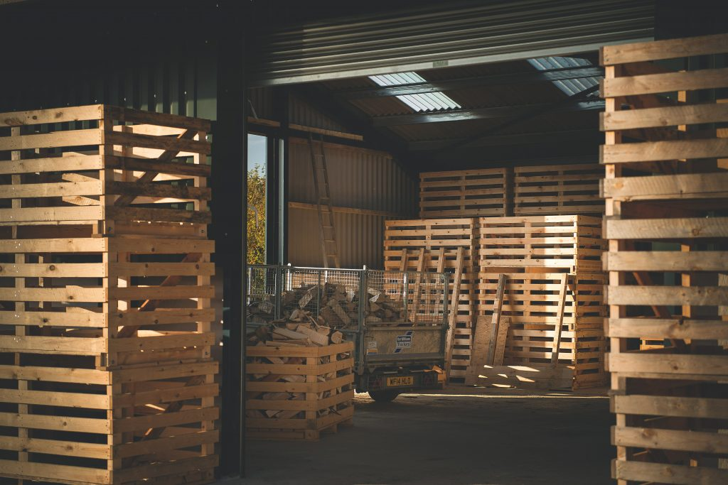 The warehouse where wood is sorted into crates before the drying process.
